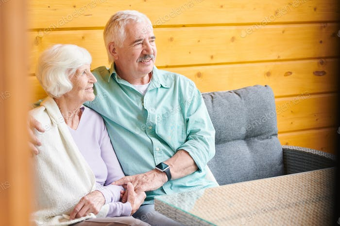 Happy and affectionate senior spouses in casualawear