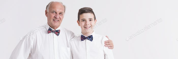 Grandfather and grandson in bow ties