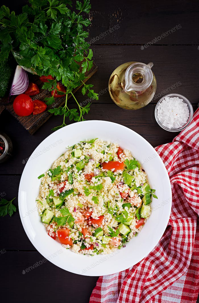 Traditional Lebanese Salad Tabbouleh. Couscous with parsley, tomato, cucumber, lemon and olive oil