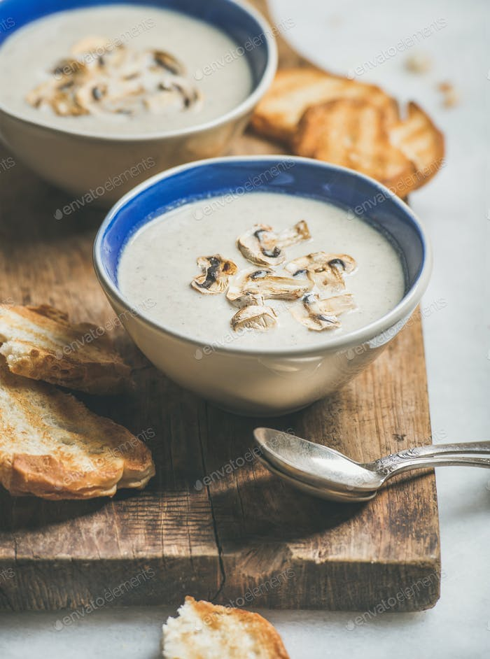 Healthy dinner with creamy mushroom soup and grilled bread
