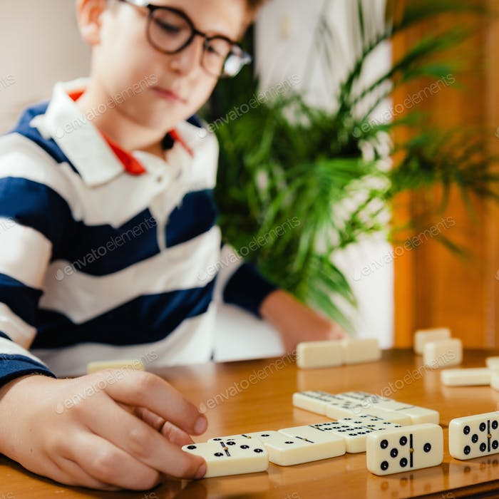 Boy playing dominoes