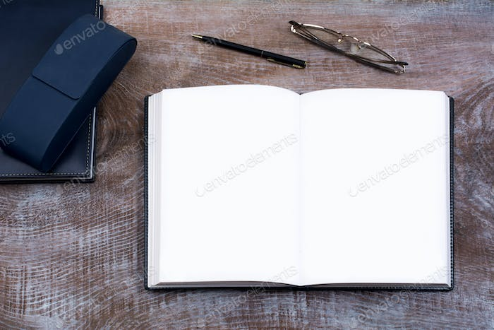 Mockup of open notebook with blank pages.