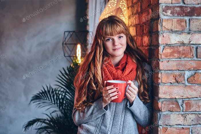 Redhead female in a red warm hat and gloves.