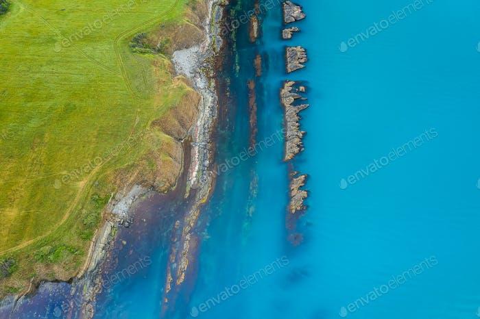 Top view of picturesque rocky coastline