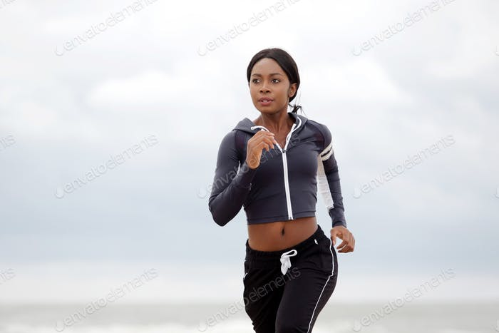 young black sports woman running outdoors