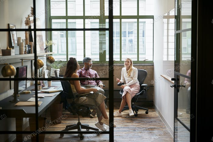 Business team meeting in an office booth