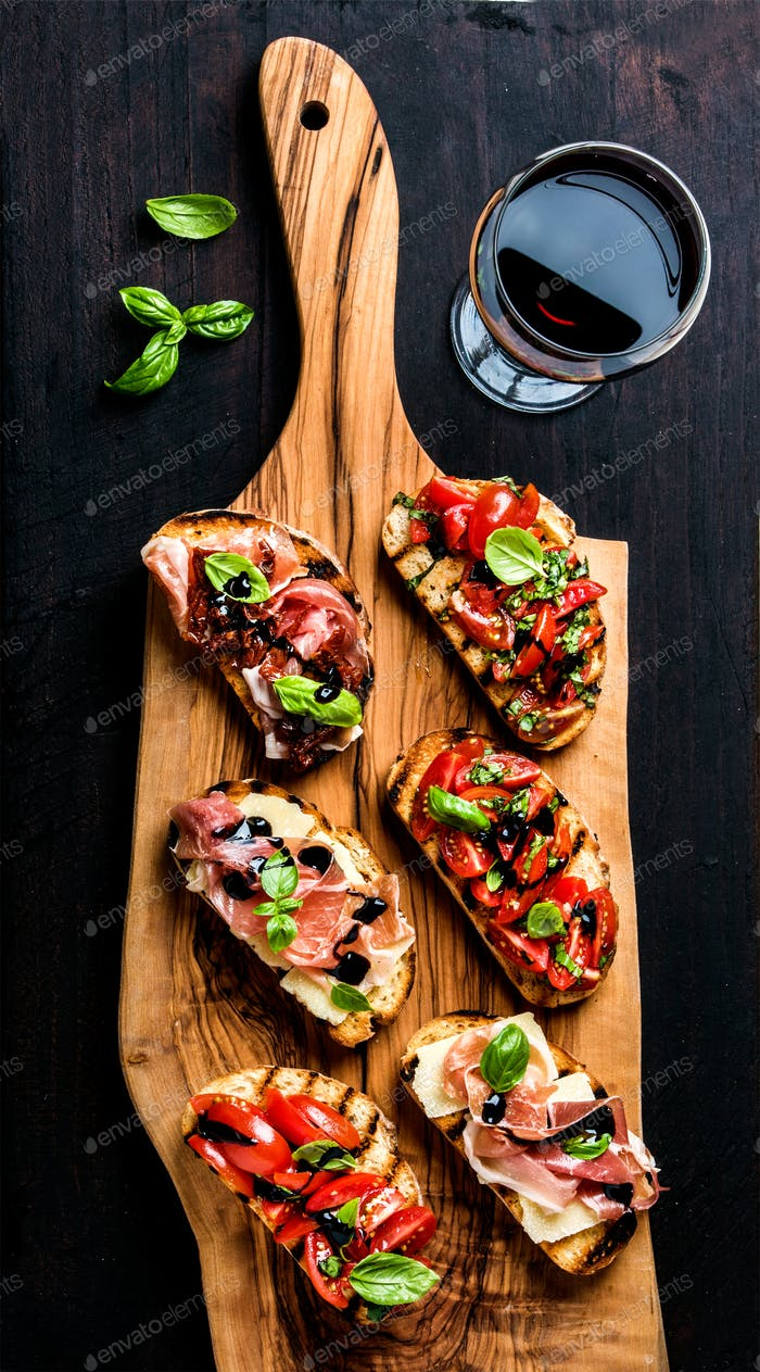 Brushetta set and glass of red wine