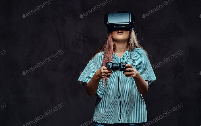 Girl using virtual reality glasses in a dark studio