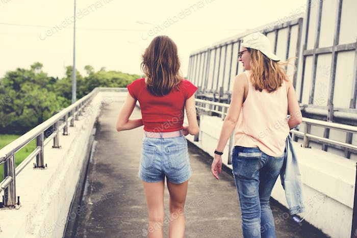 Rear view of women walking together