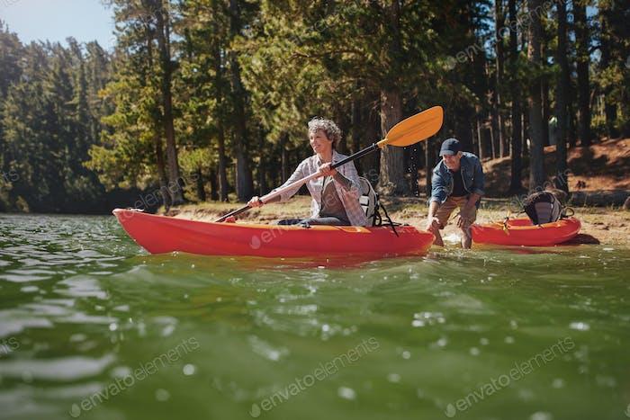 Mature couple having fun kayaking in the lake