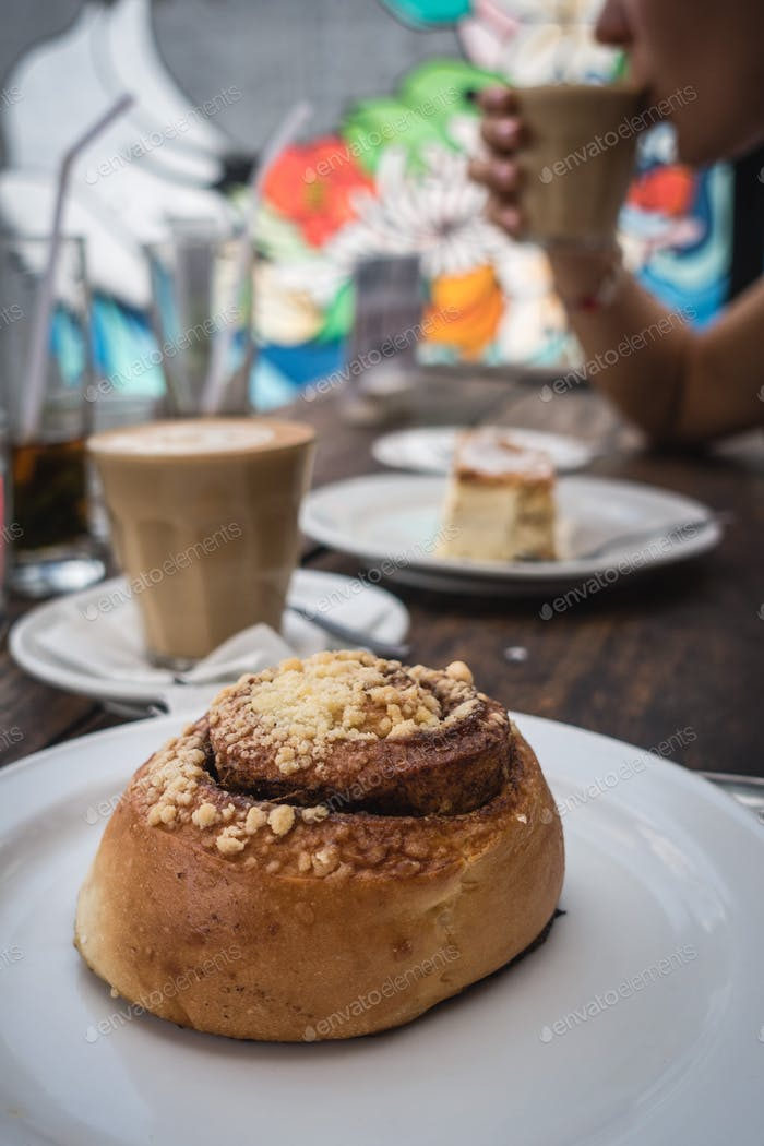 Heavenly cinnamon roll with great coffee in a coffeeshop