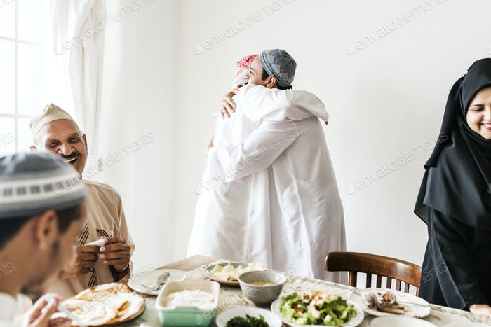 Muslim men hugging at lunchtime