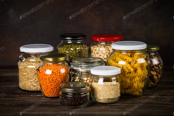Cereals, Legumes, and beans in glass jars on kitchen table