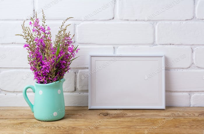 White frame mockup with maroon purple flowers in mint pitcher