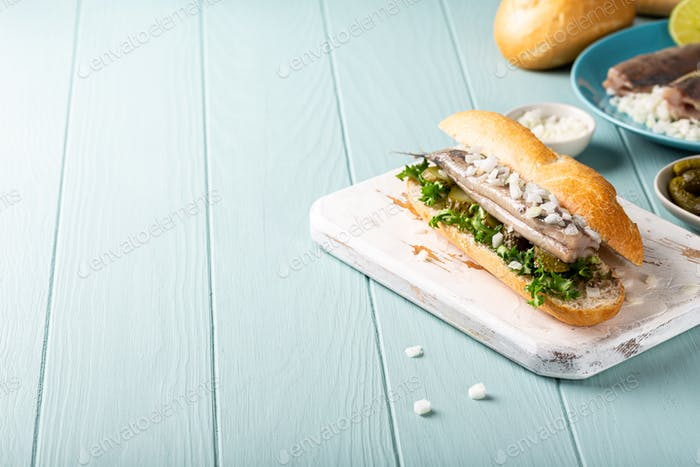Traditional dutch snack, seafood sandwich with herring