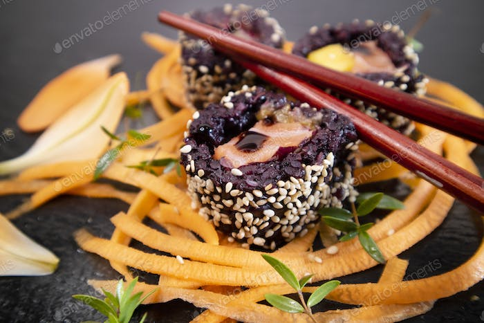 Black rice and carrot sushi