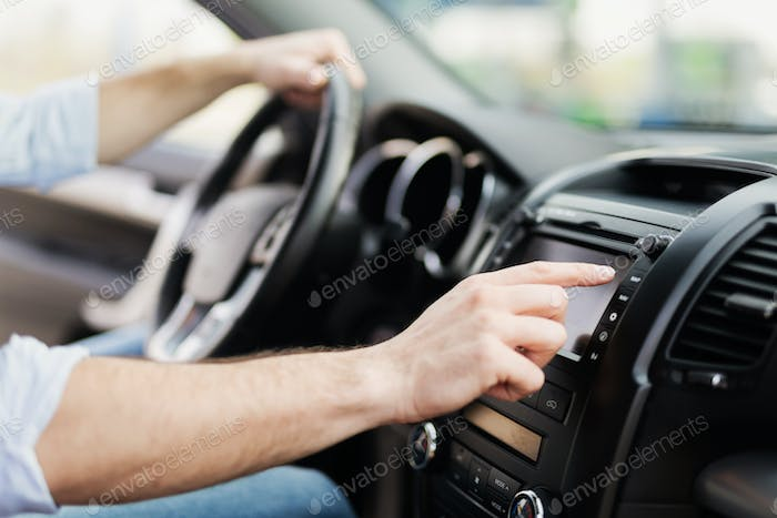 Man Using Gps Navigation System In Car