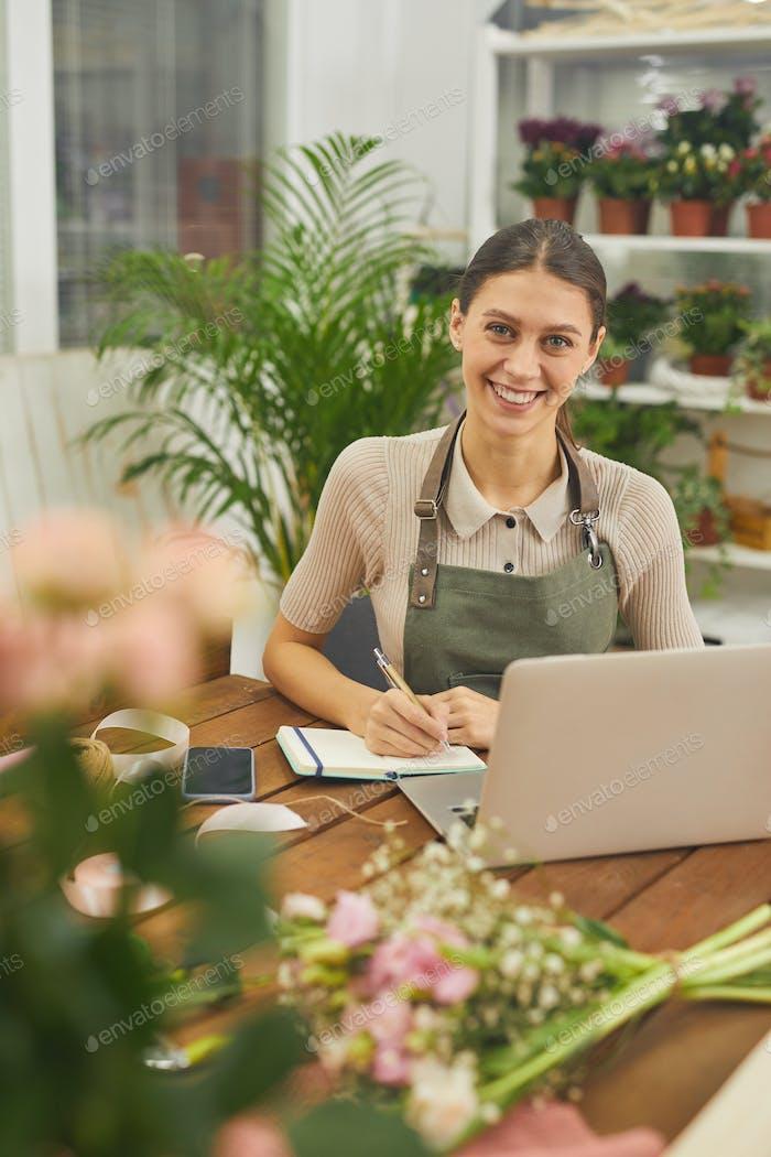Smiling Businesswoman Managing Flower Shop