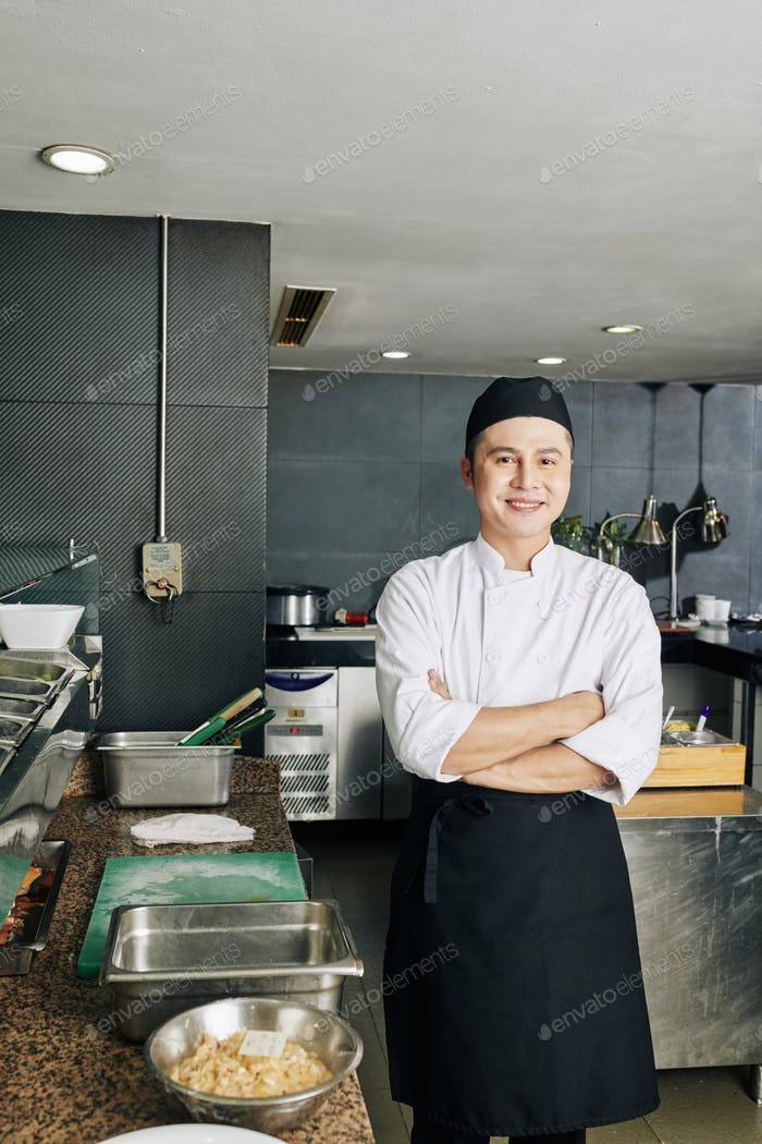 Asian cook in the restaurant