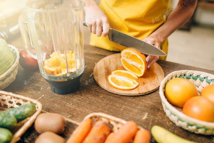 Housewife cooking orange juice, organic food