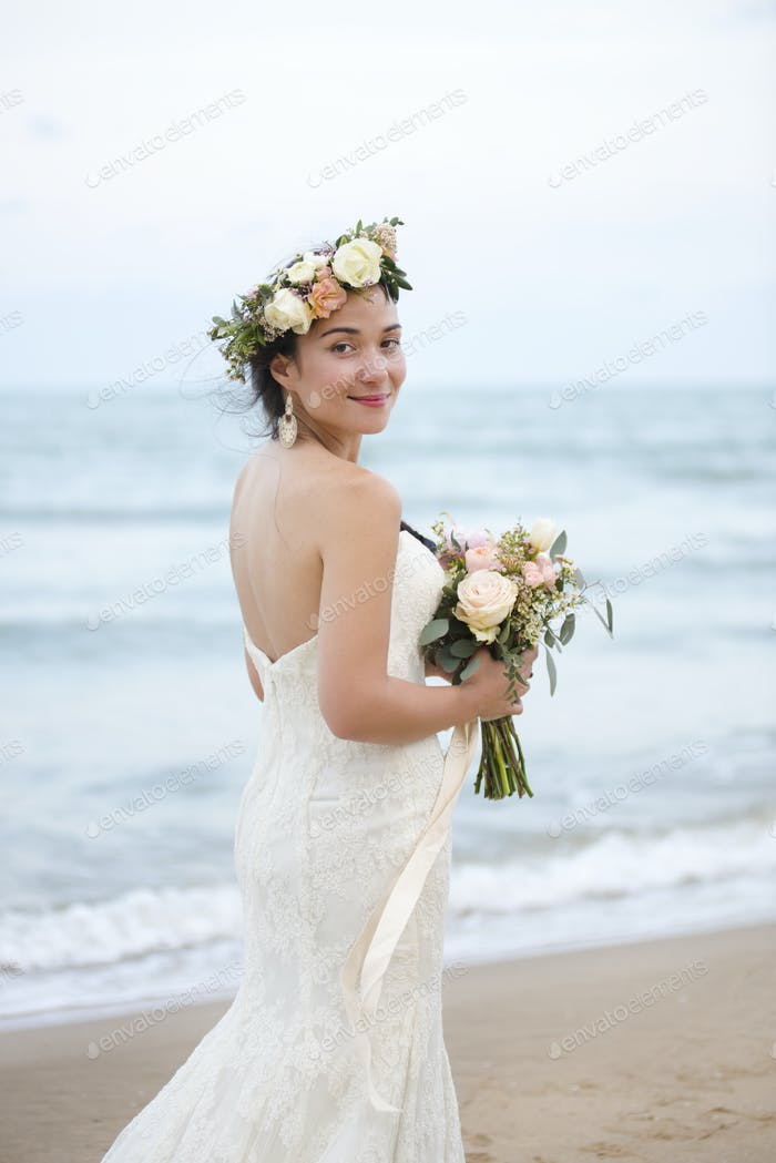 Beautiful bride by the sea
