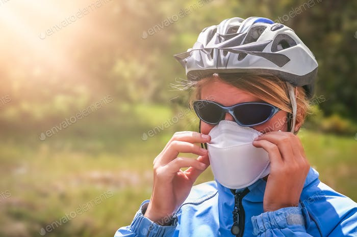 Cyclist wearing a protective mask