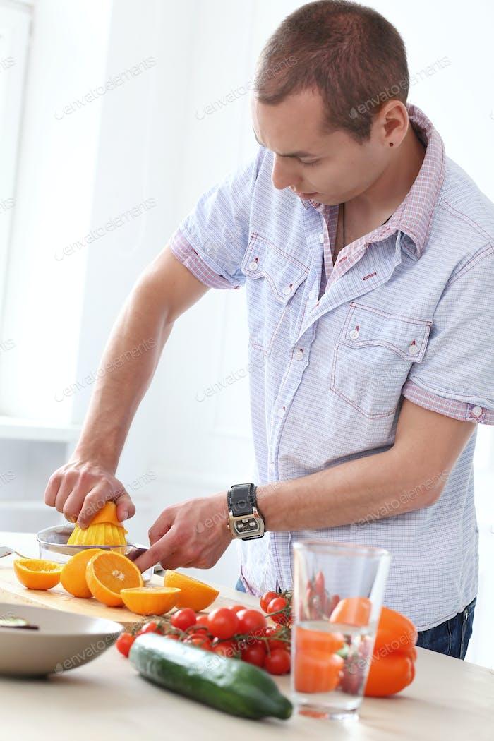 Food. Gorgeous man at kitchen