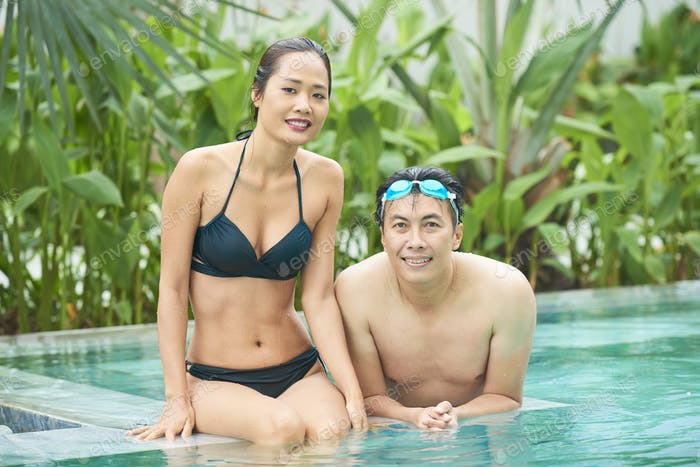 Asian couple in swimming pool