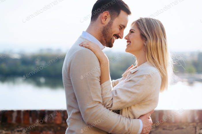 Happy young couple smiling and dating outdoor