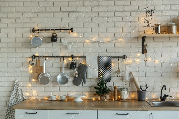 Interior light kitchen with christmas decor and tree