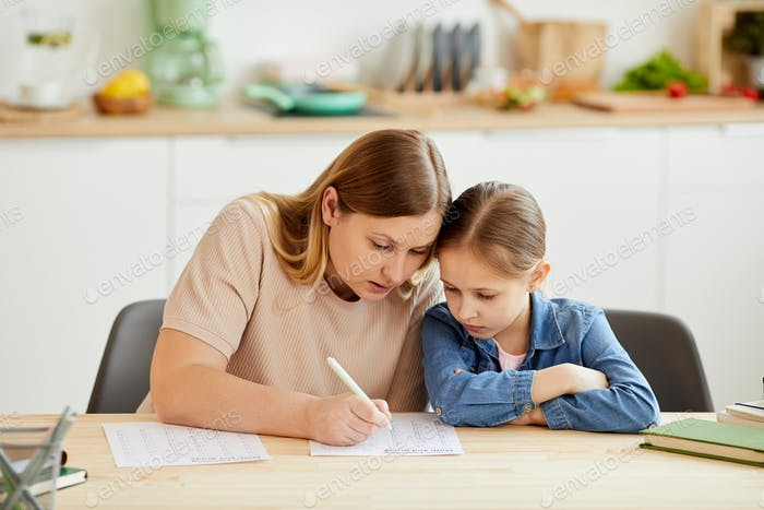 Mother Helping Daughter Studying at Home