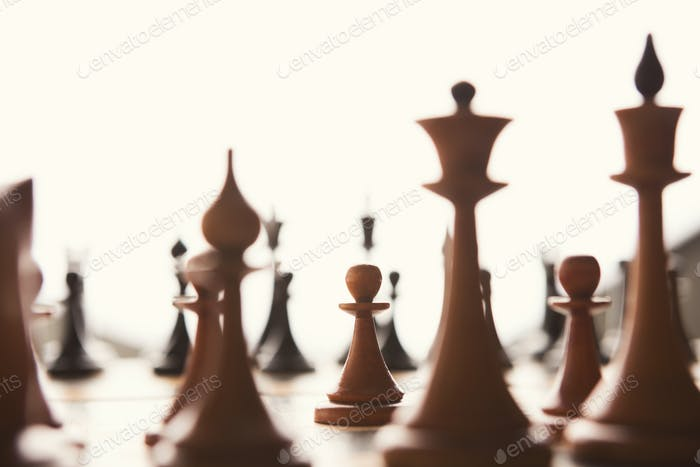 Silhouettes of chess figures on white background