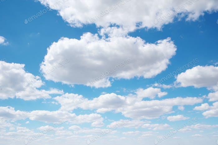 White clouds and deep blue sky at day.
