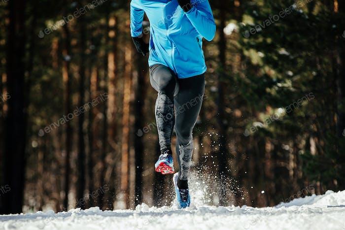 athlete runner running in winter trail