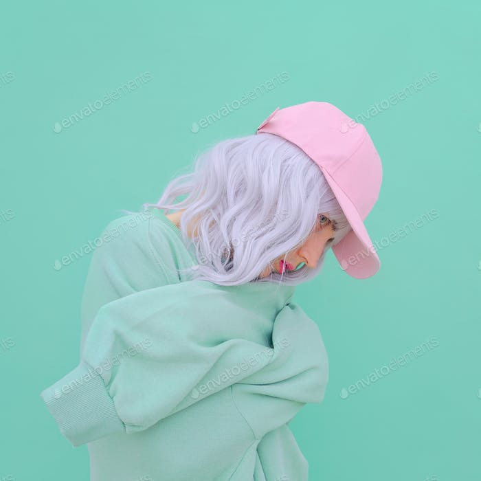 Aesthetic girl in stylish accessories b-boy cap. Fresh vanilla pastel colours monochrome fashion