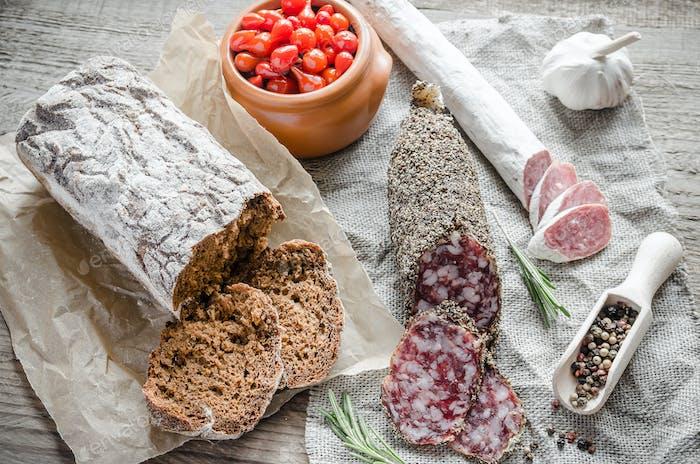 Slices of saucisson and spanish salami on the sackcloth