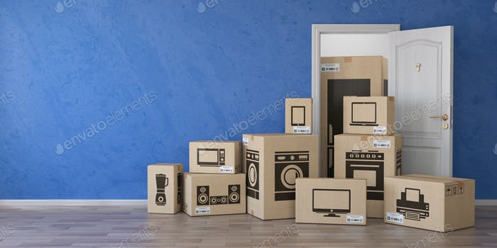 Household kitchen appliances and home electronics in cardboard b
