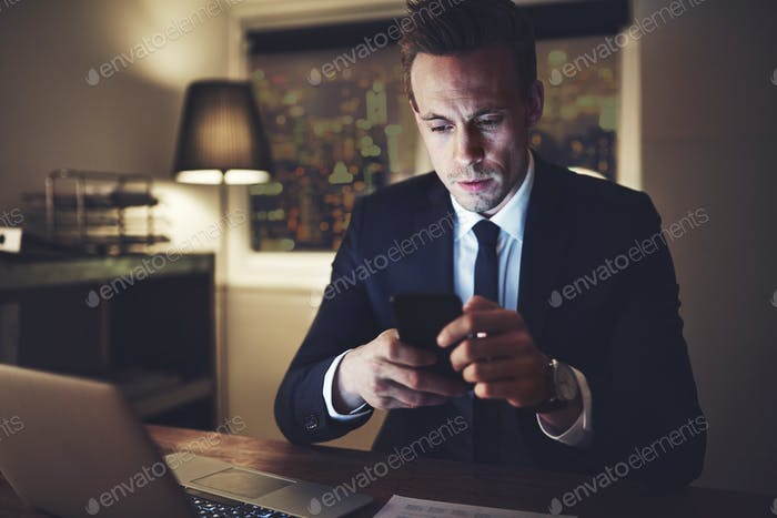 The accountant in the office surfing smartphone