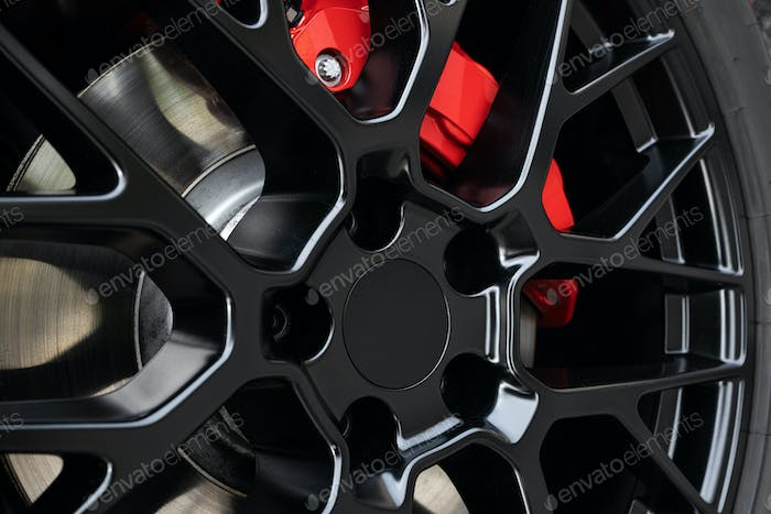 Sport rim and red brake caliper of car