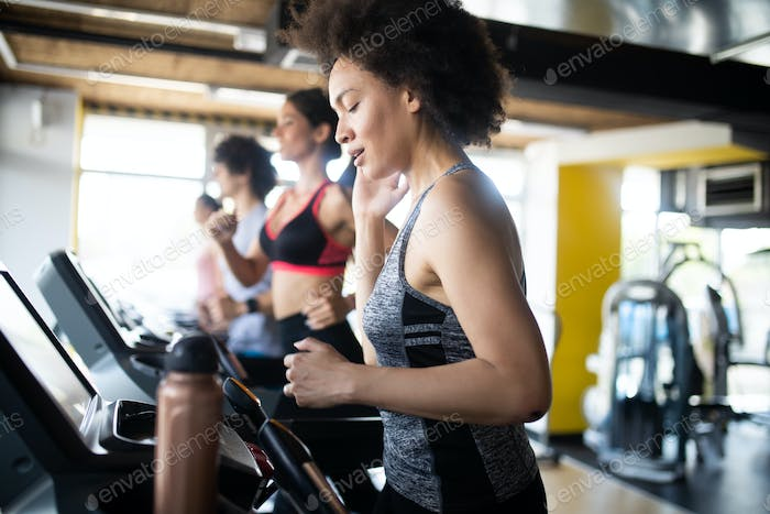 Group of multiethnic sports people make sport exercise in gym
