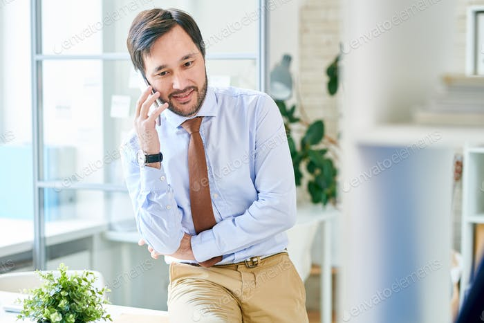 Content businessman having phone call