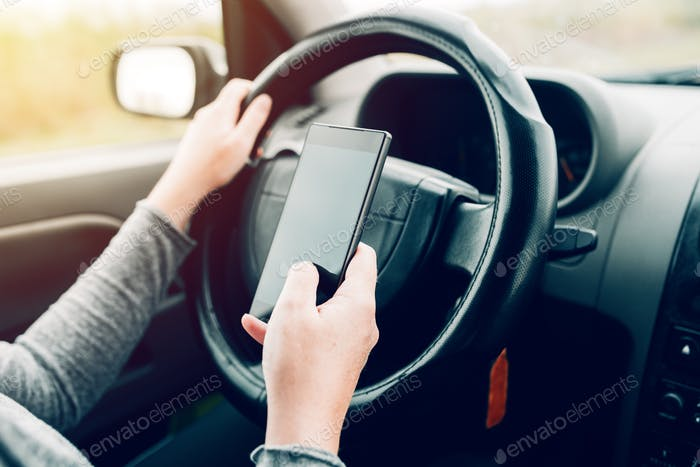 Woman using car navigation on smartphone
