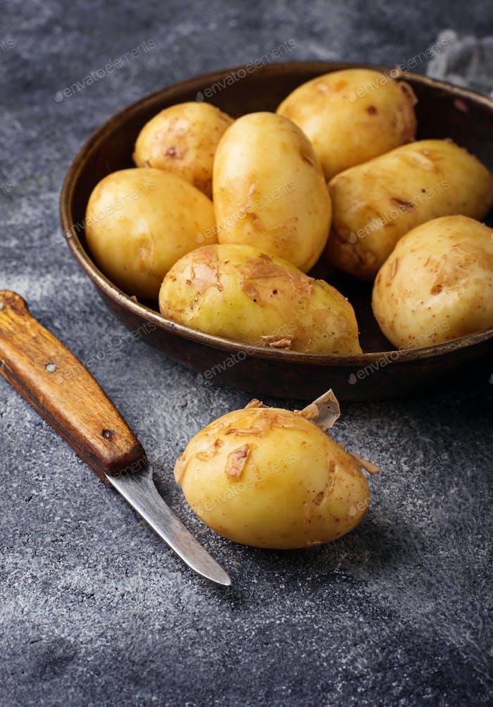Raw potato in basket