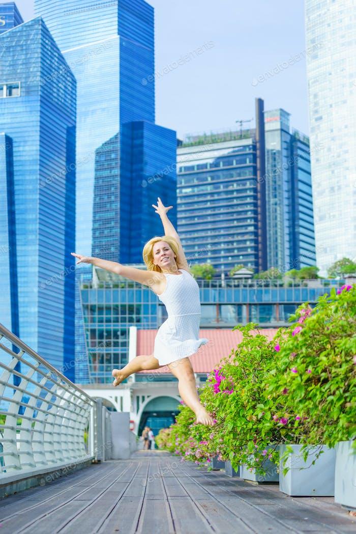 Elegant ballet dancer woman dancing ballet in the city