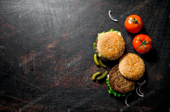 Burgers with gherkins and tomatoes.