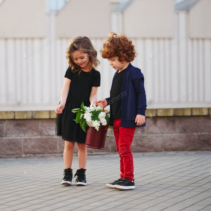 little boy and girl with big lilac bouquet