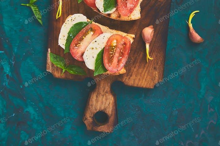 Bruschetta with tomatoes, mozzarella cheese and basil