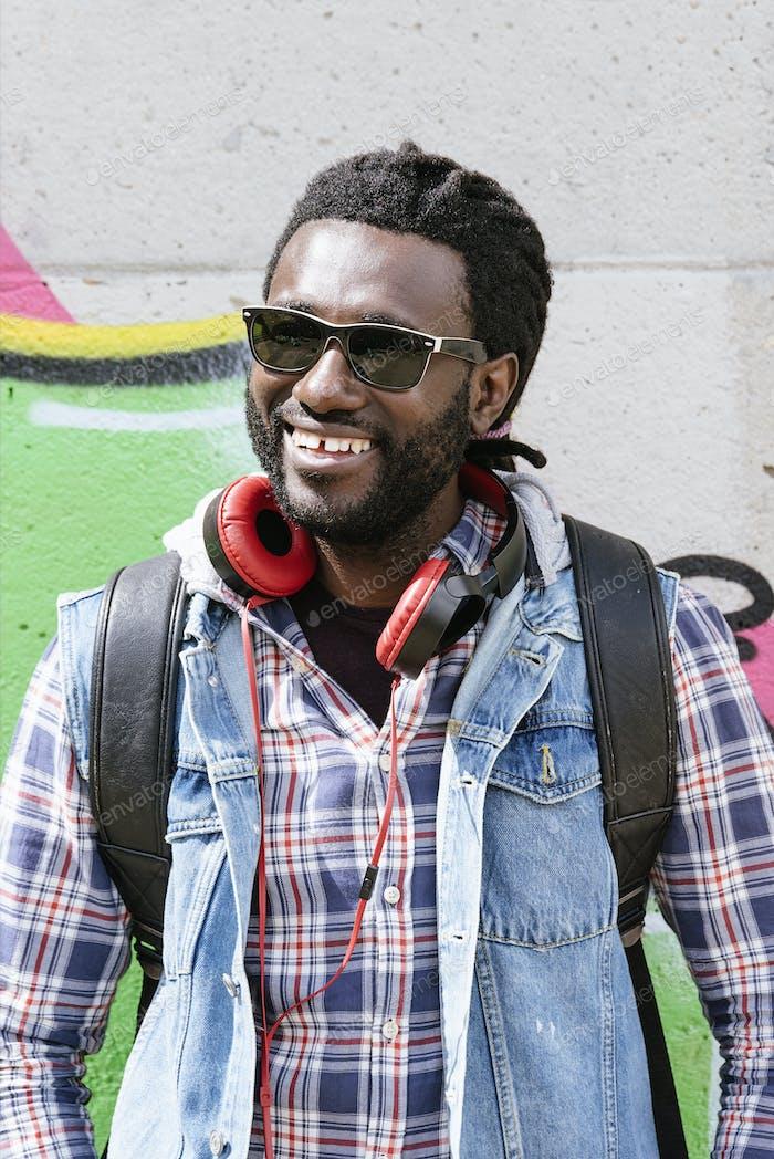 Portrait of a black man smiling.