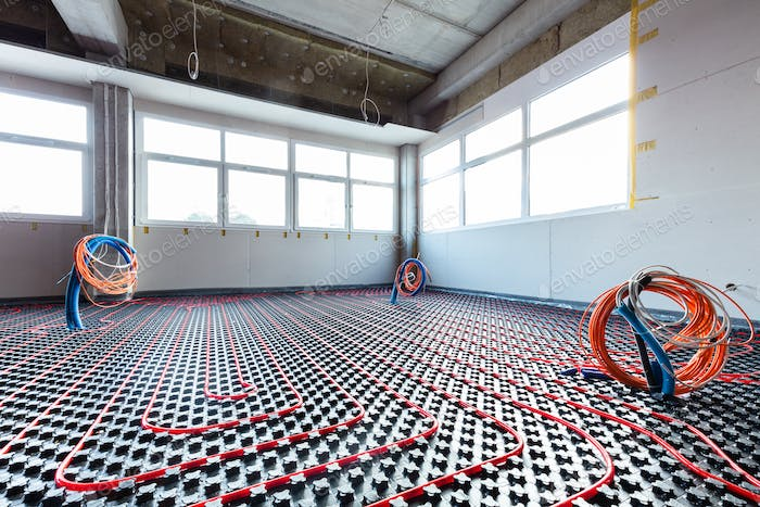 Floor heating and electrical outputs in a new building. Interior design