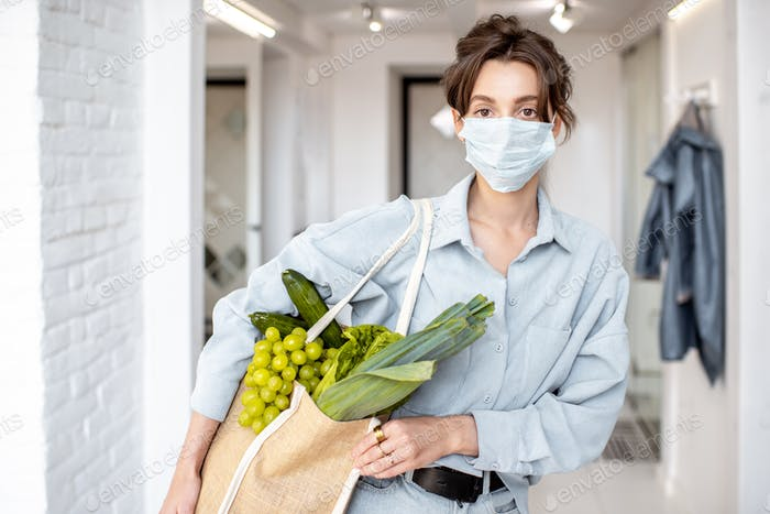 Woman in medical mask shopping food